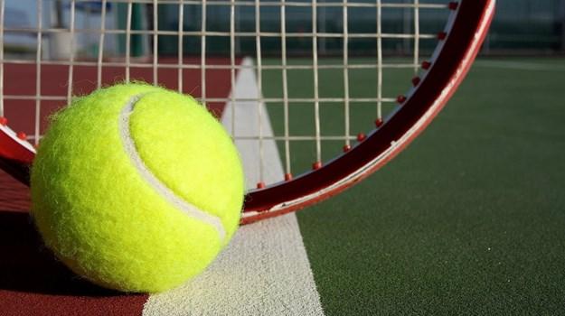 Tennis Edges Northwest to Cap Busy Week